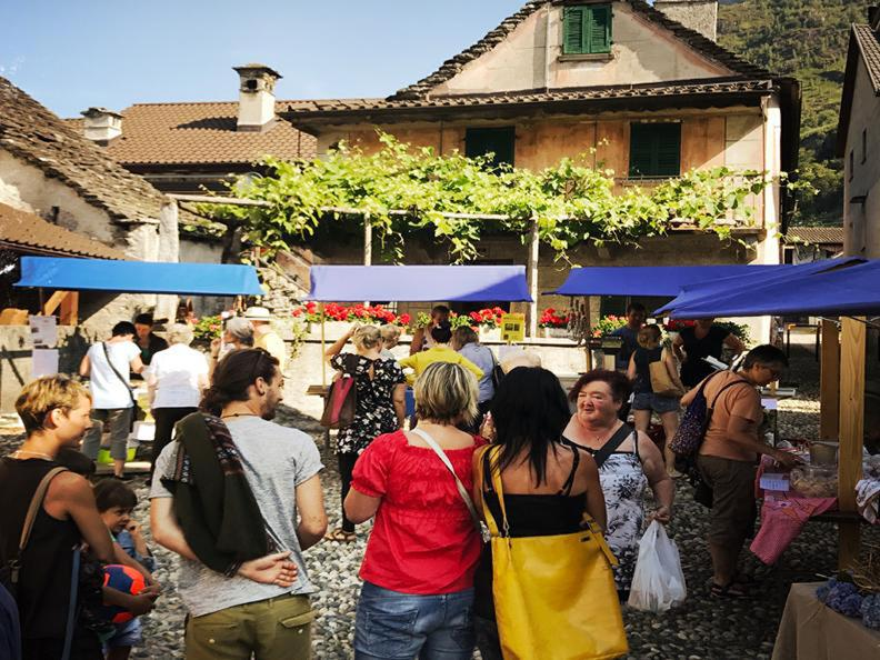 Image 0 - Alimentary market in the square of Maggia