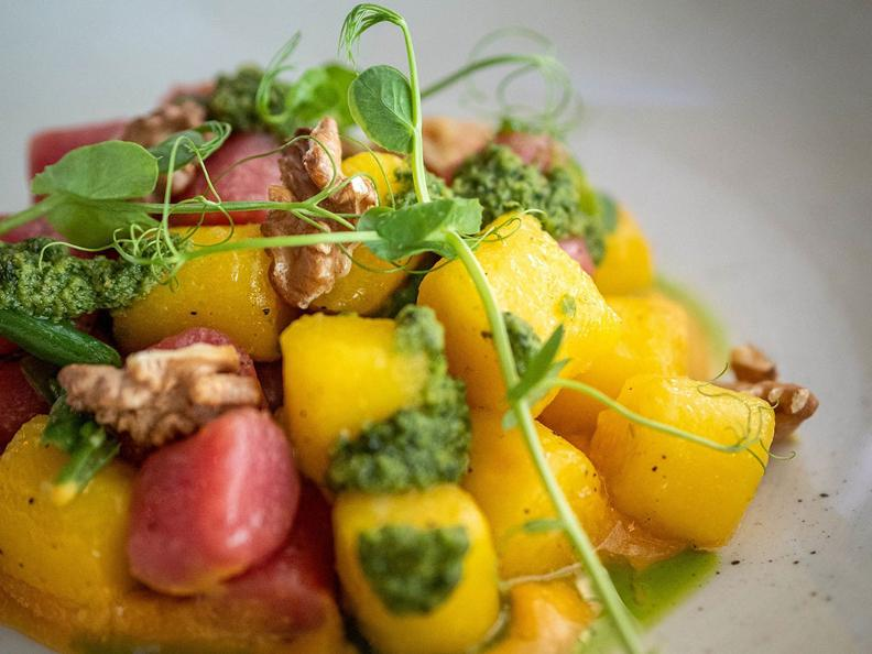 Image 1 - Colourful potato gnocchi with carrot cream, celery pesto and roasted nuts - The recipe